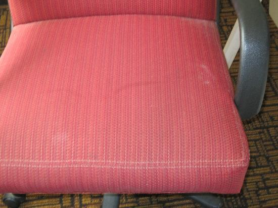 Quality Inn & Suites: Stained chair