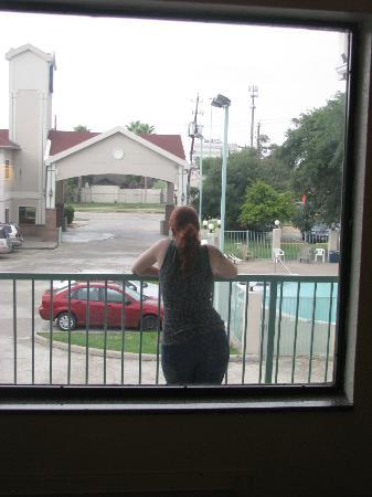 Super 8 Houston/Brookhollow NW: My wife looking over the parking lot and pool area
