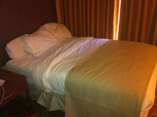 "Embassy Suites by Hilton San Marcos - Hotel, Spa & Conference Center: This bed was not slept in - this was after it was ""made"" by housekeeping"