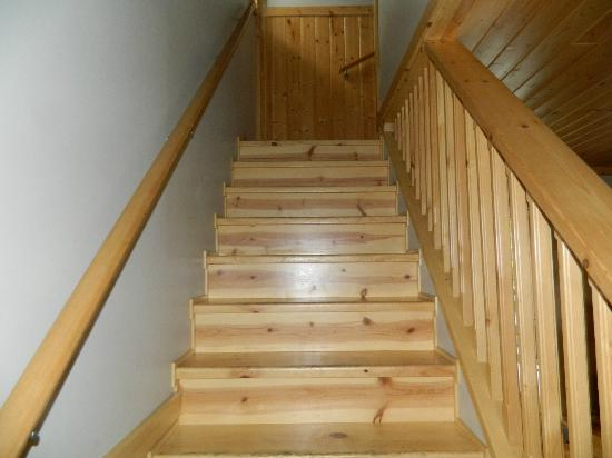 Reef Point Cottages: staircase to 2 bedrooms and bathroom