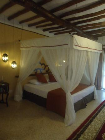 Karafuu Beach Resort and Spa: master suit bed