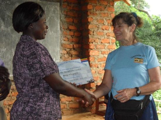 Adonai House: Sue receives a Thank You to her and husband John for the support they've given Bridge of Hope Sc
