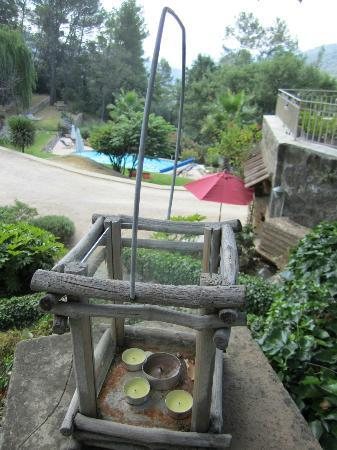 Le Mas de Clairefontaine: View from Mimosa room of pool and other room below (with red umbrella).