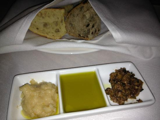 Collectors Cafe & Gallery: Bread and beans, oil, and olives looks nice but nothing special.  Bread was hard and tasteless.