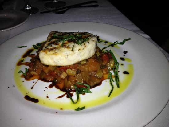 Collectors Cafe & Gallery: Small piece of Swordfish and too tangy bed of vegies