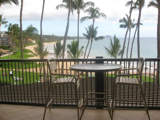Mana Kai Maui: View from our room of balcony and beach, grassy area.