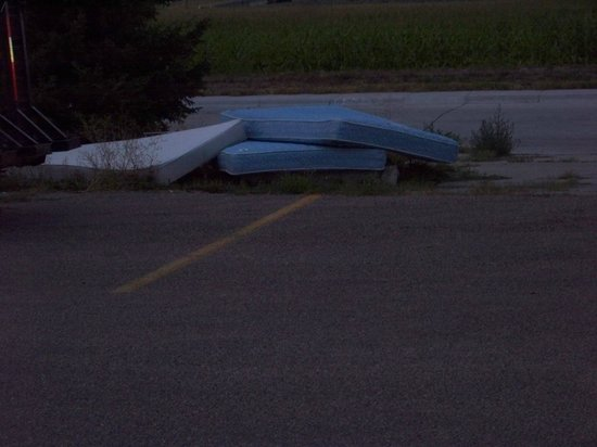 Days Inn Scottsbluff: Wonder how many bed bugs were in these.Parking lot trash