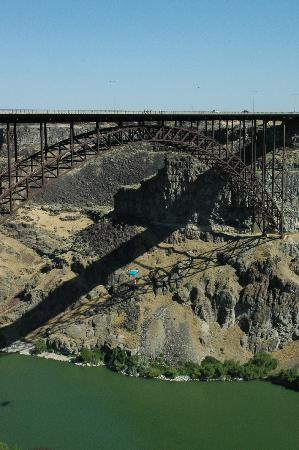Twin Falls, ID : Basejumper going off the top (midway down-blue parachute)