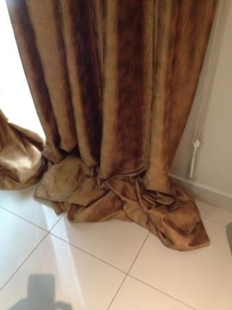 The Bellezza Suites: horden yang kepanjangan tidak sesuai dengan tinggi kamar