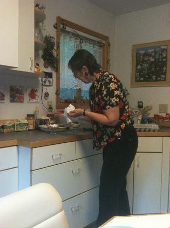 Alaska Chalet Bed & Breakfast: Brigitte fixing one of our luscious breakfasts in the Alaska Chalet Suite