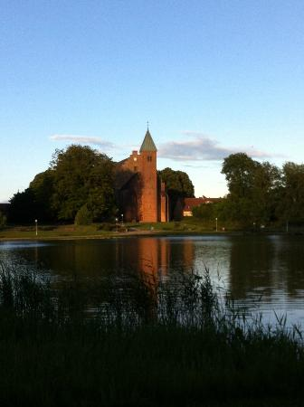 Maribo, Danmark: The cathedral, view from across the lake