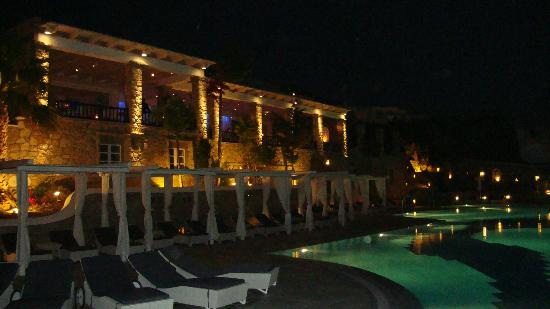 Mykonos Grand Hotel & Resort: the pool and dining room at night