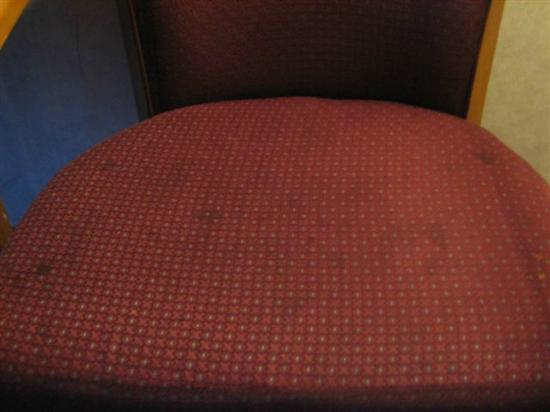 Americas Best Value Inn- Benton Harbor: Chair Disgustingly Dirty, Completely Spotted & Stained