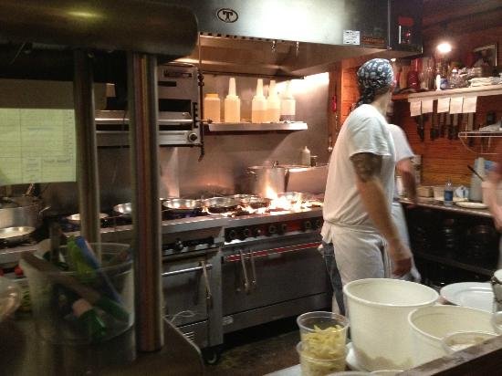 Tradewinds Imported Foods: Table side view of the kitchen
