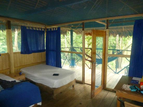 Muyuna Amazon Lodge: view of my room looking out onto the deck with comfy hammocks