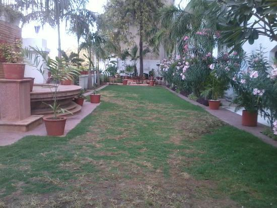 Lemon Tree Premier; The Atrium, Ahmedabad: Lawn overseeing the River Sabarmati and Nehru Bridge