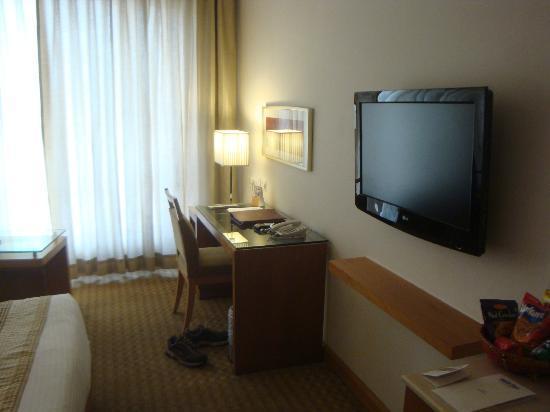 Park Inn Jaipur, A Sarovar Hotel: Large TV and desk in my guest room