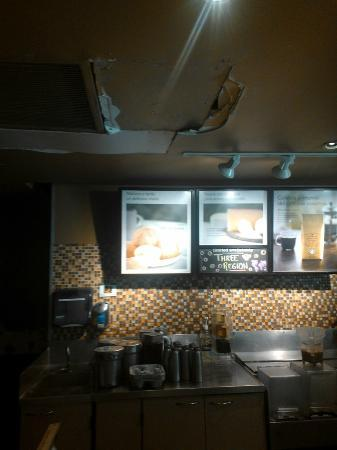 Sheraton Mexico City Maria Isabel Hotel: The starbucks is in BAD need of repair, with this hole in the roof behind the counter.