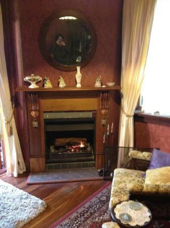 Storey Grange: The cosy lounge with open fire