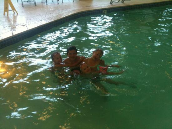 Embassy Suites by Hilton Oklahoma City Will Rogers Airport: my 12 year old and 7 year old triplets in the pool
