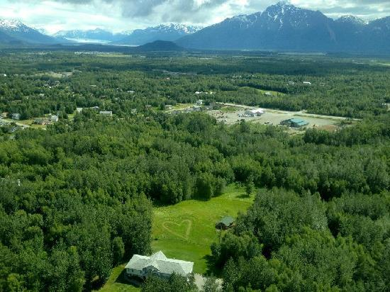 Alaska's Harvest B&B: aerial view of house and pasture