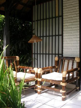 Puri Kelapa Garden Cottages: Terrace of a cottage