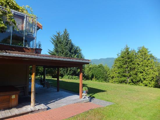 On The Inlet B&B: rear corner showing patio and view east to mountains