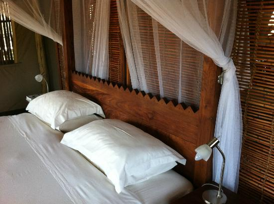 Wilderness Safaris Xigera Camp: bed with mosquito net