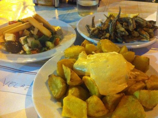 Restaurante Maribarbola: patatas bravas (where's the nice sauce?); pescaito frito; greek salad
