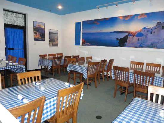 The main dining room has a fun greek cafe decor