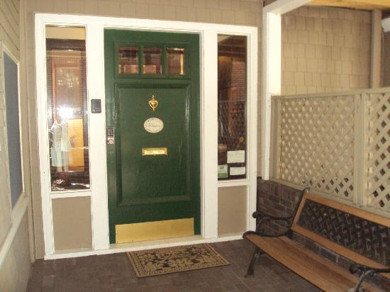 The Wales House: This lovely outer door next to benches for visiting keeps the house secure with a keypad.