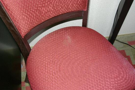 Holiday Inn Express Cleveland Airport - Brook Park: Stain on chair in my room. Time to renovate rooms, not add floors!