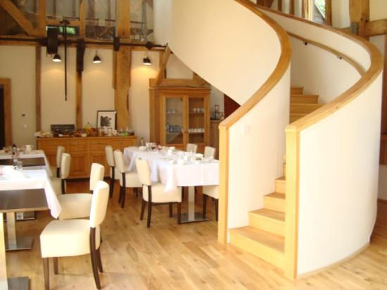 The Barn at Roundhurst: The Dining room with staircase leading to the library