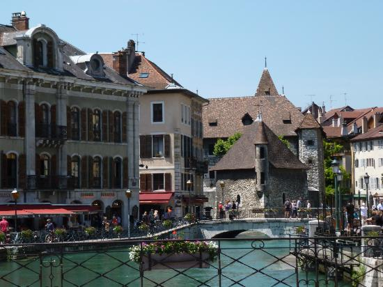 Lake Annecy Tourist Office: Popular area for restaurants where lake empties to river - just don't be late for lunch!