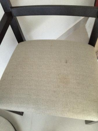 Dreams Huatulco Resort & Spa : Stained Chairs in room