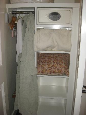 San Ysidro Ranch, a Ty Warner Property: Closet space=non-existent. Housekeeping puts bedspread on the shelves, there are no drawers.