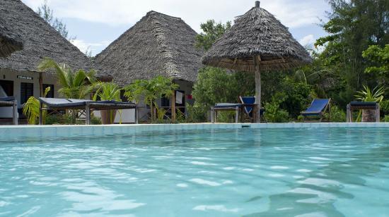 Mbuyuni Beach Village : Pool area looking back toward bungalows