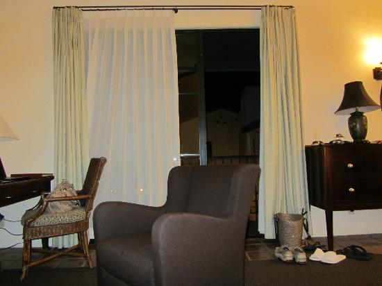 Spanish Garden Inn: sitting and desk area with tv and fireplace