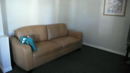 Boundary Motel: Basic sofa in empty living room