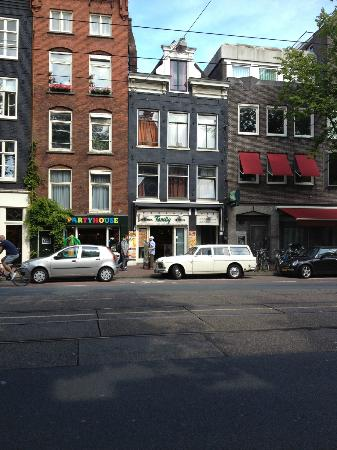 Bayan Bed n Breakfast: Exterior.  Above shop behind white car.  Hard to notice, but that's okay.