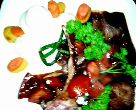 Paula's Bistro: rack of lamb provecal is one of our customers faves