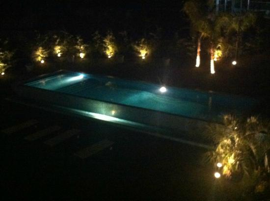 Sisai Hotel Boutique: View of the pool at night, shot from room's balcony
