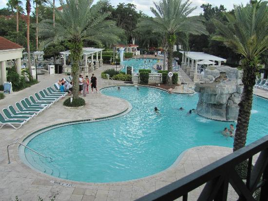 Star Island Resort and Club: A view of both pools from the upstairs patio bar