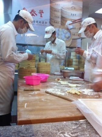 Din Tai Fung: Rollers meticulously at work wrapping the famous dumplings.