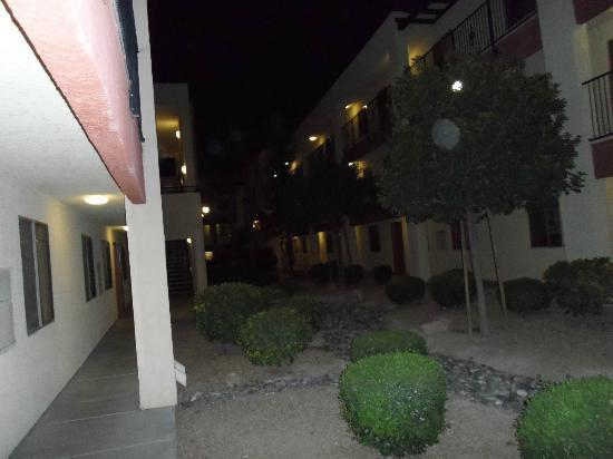 Nellis Suites at Main Gate: DIMLY lit exterior corridors outside at night-unsafe