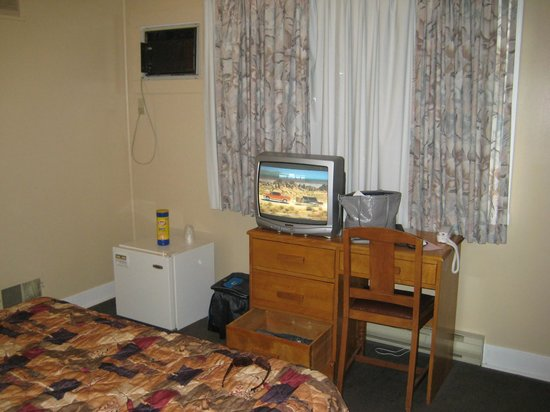 The Hawberry Motel: Television, fridge and AC unit