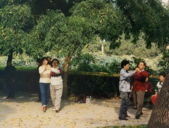 "Xixi  Friendship Hotel: Locals ""waltzing"" in the grounds..lovely."