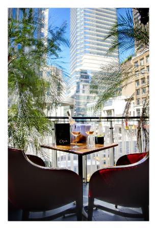 Opia's balconies overlook 57th Street and Lexington Avenue