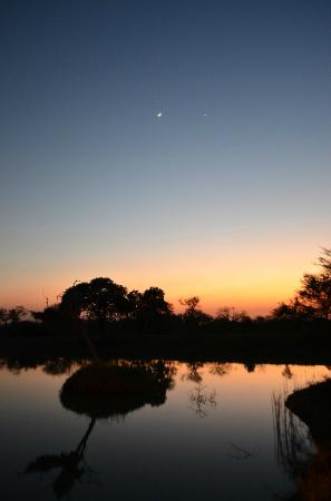 Gomo Gomo Game Lodge: Sunset over the Waterhole at Gomo Gomo
