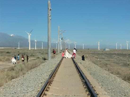 Dabancheng Wind Power Station: Wind farm, railway, peaks and brides...